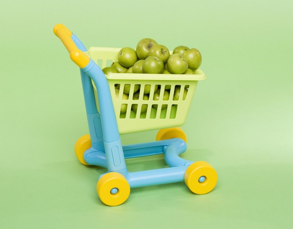 Apples in a toy shopping trolley